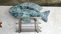 "Sullied Fish:  paint on purchased woodcarving & metal kitchen shelving;  9.5""x19"" (fish only)"